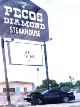 A black Mustang convertible sits incapacitated just before 5 p.m. Thursday after crashing into the sign in front of Pecos Diamond Steakhouse, 601 S. First St. The driver, identified as Charlie Everrett Bogle, 34, of Artesia, told authorities he fell asleep at the wheel. Bogle was cited for careless driving and driving without a license. He was also arrested at the scene for being a fugitive from justice.  Jamey Powers – Daily Press