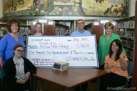 From left, Sara Sims, Erin Loveland, Laura Simon, Gary Sims, Sandi Lanning and Anna Byers gather recently at the Artesia Public Library for the presentation of a $1,500 donation from J.S. Ward &Son Inc. to the Friends of the Library.  Courtesy Photo