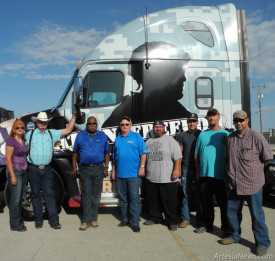 Pictured from left standing with Werner Enterprises' Freedom Truck 1 are Edna Wilson, Artesia Training Academy student director, Will Crockett, ATA owner, Jon Jon Everett, Werner Southwest regional manager, David Conkling, Freedom Truck 1 driver, ATA students Anthony Aragon, Chris Pinon and Robert Snell, and Eric Taylor, ATA instructor.  Teresa Lemon – Daily Press