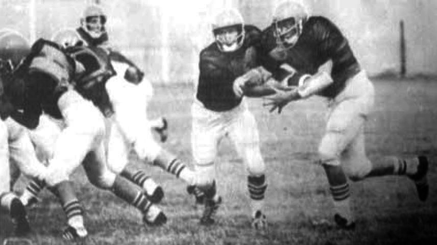 Jerry Brown, Bulldog quarterback, hands fullback Randy Hill the football while guard John Bilberry and tackle Elton Menefee open a hole for Hill through the defense. The Bulldogs are practicing at Bulldog Bowl now in preparation for this weekend's scrimmage with Brownfield. AHS opens the season here Sept. 5 against Roswell Goddard. (Daily Press File Photo)