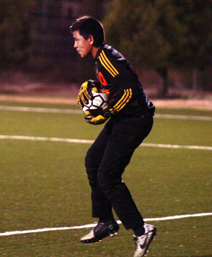 Freshman keeper Aaron Natera nabs an Alamogordo shot during the second half Thursday. (Brienne Green - Daily Press)