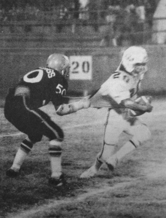 Bulldog defensive tackle Mitchel Johnson had a good grip on the shirttail of Parkland running back Raul Sanchez Friday night. He made the tackle, if you can call it that. (1975 Daily Press File Photo)