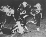 Bulldog running back Kenneth Harcrow took his toll Friday night on the Alamogordo Tiger defense. He slipped past the Tigers 12 times, gained a total of 140 yards, and cracked in one touchdown for the Bulldogs. Harcrow, No. 22, is shown above in his winning form, assisted by the blocking of No. 68, John Bilberry. (1975 Daily Press File Photo)