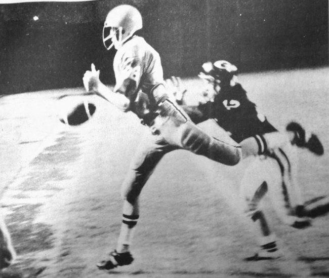 OOPS! - (From 1975) Bulldog split end Henry Terpening could not hold onto the wet football and had to watch a Jerry Brown pass sail out of bounds as a Roswell Goddard defender pursues on the play. Despite the rain and wet field, the Bulldogs won their season-opener, 21-0, and meet Clovis next week. (Daily Press File Photo)