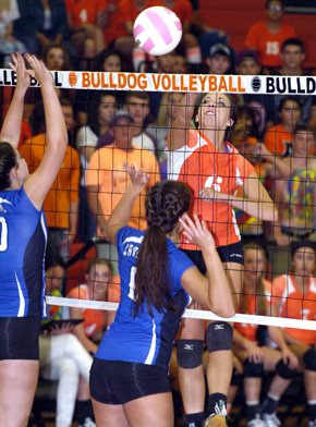 Bulldog senior Jenna Butcher delivers a kill during Game One of Artesia's 3-0 win over Carlsbad Tuesday at Bulldog Pit. (Brienne Green - Daily Press)