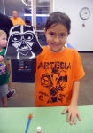 Haylie Phelps holds up a Darth Vader puppet she made Saturday afternoon during the arts and crafts portion of the Artesia Public Library's Star Wars Day. The event, organized by Erin Loveland, teen services librarian, also featured trivia, snacks, and a costume contest. (Elizabeth Lewis - Daily Press)