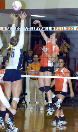 Jenna Butcher places a kill over the outstretched hands of a Goddard blocker during Game One Tuesday at Bulldog Pit. (Brienne Green - Daily Press)