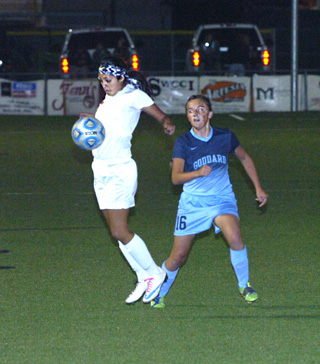 Elisa Cardenas secures the ball in front of a Rocket defender during the first half Tuesday at The Mack. (Brienne Green - Daily Press)