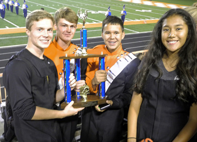 Members of the Artesia High School marching band, from left, Jamey Kennemur, Kasey Bartley, Josh Rivera and Andrea Alvarez, hold the band's trophy after nabbing a Division I rating Tuesday at the annual marching festival at Bulldog Bowl. (Elizabeth Lewis - Daily Press)