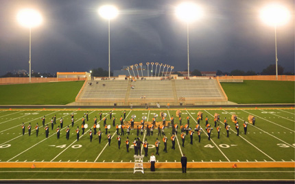 The Artesia High School marching band and color guard both perform Tuesday evening at the 52nd Annual Southeast New Mexico Music Educators Association District Marching Festival at Bulldog Bowl. (Elizabeth Lewis - Daily Press)