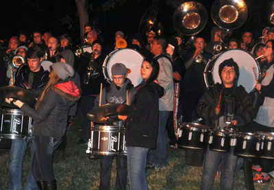 "The Artesia High School marching band plays ""Hey Baby"" during the Balloons & Tunes Fire Concert Saturday night at Eagle Draw. A trio of hot air balloons accompanied the band, firing their burners along with the music. (Elizabeth Lewis - Daily Press)"
