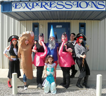 Expressions salon employees, from left, get in the Halloween spirit with a variety of costumes. Pictured are, from left, Brenda Jacquez, Haylee Neel, Angie Jarrett, Jordan Ezell, Meghan Harris, Priscilla Quinones and Celene Sepulueda. In front is Angel Nava. (Elizabeth Lewis - Daily Press)
