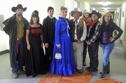 Employees of Yates Petroleum Co. dressed up in an Old West theme Friday. Pictured from left are Daniel Rodriguez, Ruthanne Stubblefield, DeeAnn Baer, Kathy Lewis, Danny Olds, Britni Rouse, Mandy Apodaca and Lupe Herrera. (Elizabeth Lewis - Daily Press)