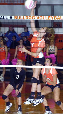 Mattie McCombs sends a kill over the net during Game Three Thursday at Bulldog Pit. (Brienne Green - Daily Press)