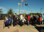 Veterans in the crowd Wednesday at Artesia's Veterans' Day ceremony at Baish Park stand to be recognized. (Teresa Lemon - Daily Press)