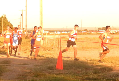 Chance Mitchell, far left, Kale Mauritsen, third from right, and Rafael Molina, far right, round the corner during Artesia's home meet. (Teresa Lemon - Daily Press)