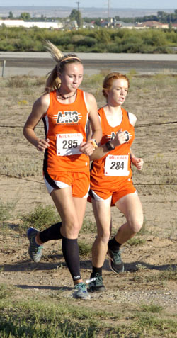 Madilynn Moon, left, and Michaela Phipps keep pace with one another during the Coach 'Mo' and Marquise' Weast Memorial Meet Oct. 1 at Jaycee Park. (Brienne Green - Daily Press)