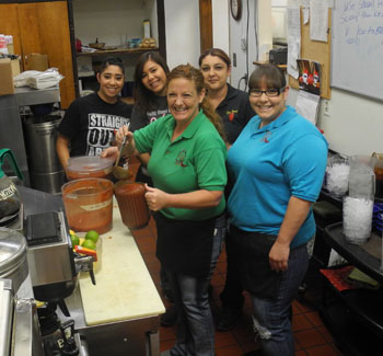 Pictured from left, La Fonda's wait staff prepare to serve the daily salsa. They are Rebecca Carbajal, Kimberly Garcia, Kim Clark, Corina Sentell and Nici Porter. Together, they have 58 years of combined wait staff experience. (Teresa Lemon - Daily Press)