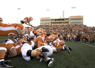 The crowd at Bulldog Bowl cheers on the 'Dogs as they leap into the Dogpile. (Tyler Green - Daily Press)