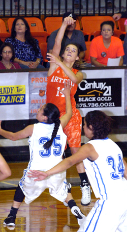 Alissa Wagner drains a three during the first quarter Thursday against El Paso Bowie at Bulldog Pit. (Brienne Green - Daily Press)