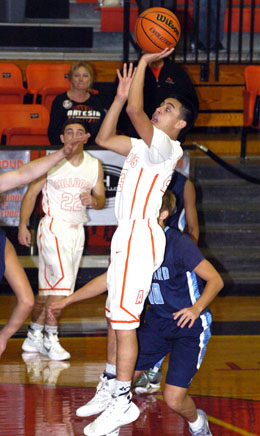 Carlos Caldera puts up a jumper during the second quarter Saturday against Goddard at Bulldog Pit. (Brienne Green - Daily Press)