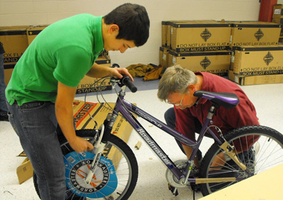 Volunteers construct bicycles at last year's Ride for Bikes assembly event. (Courtesy Photo)