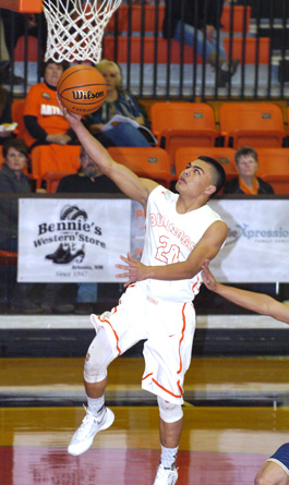Carlos Carrasco sails in for a layup off the steal during the first quarter Tuesday against Ruidoso at Bulldog Pit.