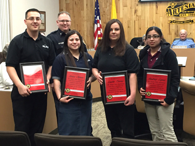 Cmdr. Lindell Smith, back, presents Skye Huerta, Anna Olguin, Leslie Torres and Audrey Lopez with plaques Tuesday honoring their services assisting officers who reside in Roswell during winter storm Goliath. (Elizabeth Lewis - Daily Press)