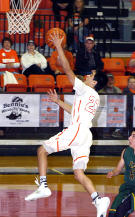 Carlos Caldera sails in for a breakaway layup during the during the second quarter Monday at Bulldog Pit. (Brienne Green - Daily Press)