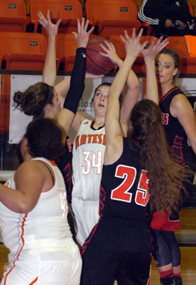 Paityn Houghtaling is harassed under the basket by Portales sisters Kambrey and Lindsay Blakey during the first quarter Tuesday at Bulldog Pit. (Brienne Green - Daily Press)