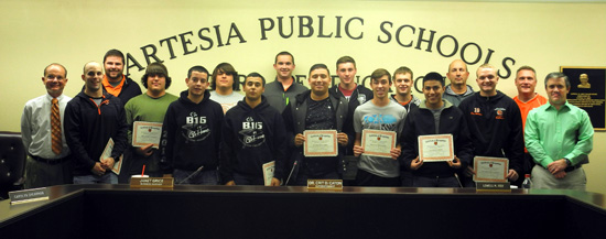 Some of the senior members of the 2015 Class 5A State Champion Bulldog football team pose with their coaches Thursday after being honored by the Artesia Public Schools Board of Education. Pictured from left are head coach Cooper Henderson, coach Stephen Johnston, coach Jeremy Maupin, Andrew Pierce, Brandon Reza, Anthony Pierce, Daniel Hernandez, Tristan Bowden, Jacob Flores, Cooper Hall, Clay Donaghe, Grady Frost, Josh Fodge, coach Ridge Bowden, Chaz Matthews, coach Jeff Willingham, and coach Rex Henderson. (Teresa Lemon - Daily Press)