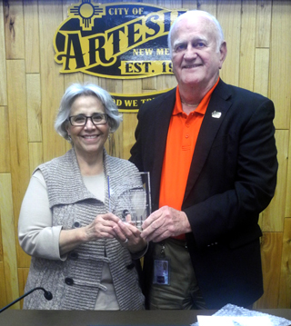 Mayor Phil Burch presents city councilor Nora Sanchez with an award Tuesday in recognition of her service on the city council for eight years from 2008-16. Sanchez has decided not to run for reelection this year. (Elizabeth Lewis - Daily Press)