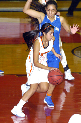Elisa Cardenas dribbles around Lovington's Myra Salazar with an offensive rebound during the second quarter Friday at the Pit. (Brienne Green - Daily Press)