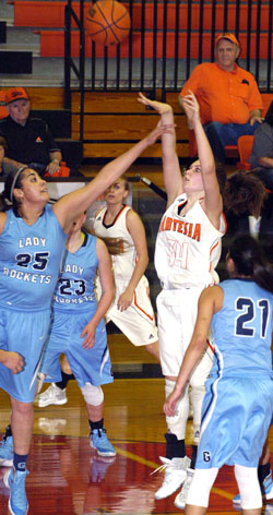 Paityn Houghtaling sends a shot past Lady Rocket Cheyenne Lopez during the second quarter. (Brienne Green - Daily Press)