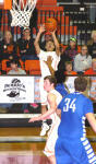Carlos Caldera drains one of his six three-pointers on the night during the second quarter Tuesday at Bulldog Pit. (Brienne Green - Daily Press)
