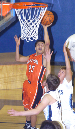Carlos Caldera sends up a jumper during the first quarter Friday at Goddard. (Brienne Green - Daily Press)