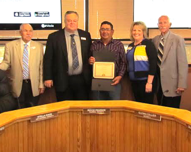 Alfredo Parraz, center, of the Eddy County Public Works Department receives a service award from commissioners, from left, James Walterscheid, Royce Pearson, Susan Crockett and Glenn Collier, for his 15 years of county service. (Courtesy Photo)