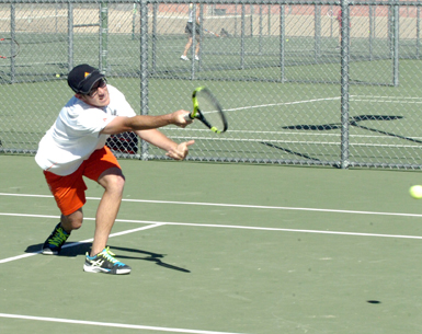 Peyton Prothro lunges to return in No. 1 boys' doubles play. (Brienne Green - Daily Press)