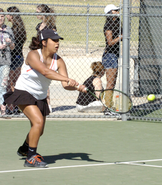 Marissa Lopez sends a serve back over the net during girls' doubles play Tuesday at The Mack. (Brienne Green - Daily Press)