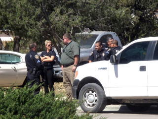 Artesia Police Department officers assist the New Mexico State Police, SWAT and other agents in search of two escaped inmates.