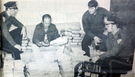 City police officers inspect the 97 kilos of marijuana, valued on the street at $100,000, confiscated from a Texas man and his female companion from Arizona late Monday evening in Artesia. Inspecting the drug haul are, from left, patrolman Randy Russell, narcotics officer Jerry Privetts, patrolman Phil Fry and chief Bobby Bishop. The marijuana, weighing some 200 pounds, is the largest quantity of narcotics ever confiscated by the Artesia Police Department. (Daily Press 1976 File Photo)