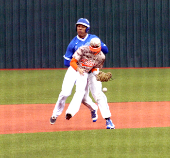Lovington's AJ Ochoa collides with Artesia shortstop Dominic Madrid as he attempts to field a ground ball during the top of the first inning in Game One Tuesday at Brainard Park. Ochoa was called out for interference on the play. (Brienne Green - Daily Press)