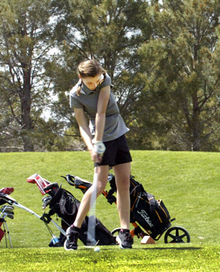 Brehnan Davis prepares to make contact during the girls' first round Monday at Spring River. (Brienne Green - Daily Press)