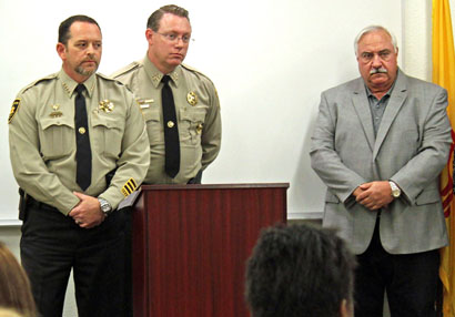 ECSO Chief Deputy Mark Cage and Sheriff Scott London address the audience Wednesday at a press conference at the Eddy County Sheriff's Office regarding the solving of the 2002 murder of Sasha Hedgecock. Alongside is David Sepich, father of Katie Sepich, in whose memory Katie's Law was created. (Elizabeth Lewis - Daily Press)