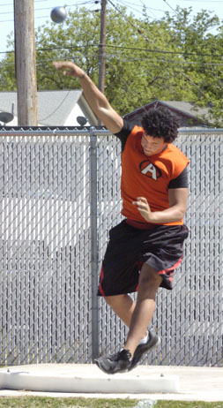 Marcus Bramwell releases the shot put during the Artesia Invitational Friday at Morris Field. (Brienne Green - Daily Press)