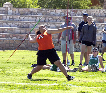Tori Collins lets the javelin fly during girls' field events Friday at Morris Field. (Brienne Green - Daily Press)