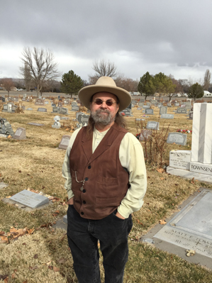 Dave Fishell, a local historian and gun collector, stands in a cemetery in Grand Junction, Colorado, after helping locate the tombstone of a suicide victim. Fishell says he contemplated suicide during past battles with depression. He's now doing suicide-prevention outreach with gun shops and shooting ranges in the area. (AP Photo - David Crary)