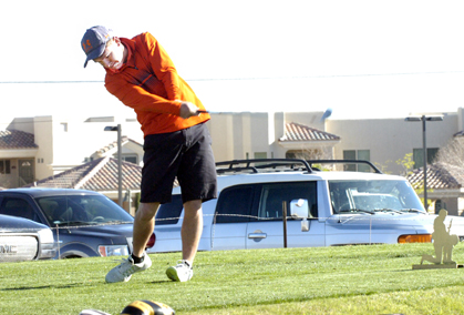 Jake Craft tees off on No. 1 Monday at the Artesia Country Club. (Brienne Green - Daily Press)
