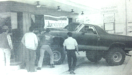 With the help of police officer Ray Byford, driver Larry Muncy attempts to dislodge his vehicle from the east side wall of the Pizza Hut on South First Street. Police reports state the vehicle was southbound on First Street when the accelerator stuck. Muncy said he swerved right to avoid another vehicle, turned off the ignition – which locked the steering wheel – and collided with the building. Damage to the Pizza Hut was estimated at $5,000-$6,000. (Daily Press 1986 File Photo)
