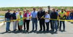 County commissioners and employees from Eddy County, Pettigrew & Associates, King Industries and the New Mexico Department of Transportation came together Tuesday morning to celebrate the grand opening of Harroun Bridge with a ribbon in Loving. The new additions to the bridge included articulated concrete blocks and the application of an epoxy overlay. Pictured, from left are Claudius Sanchez of Pettigrew & Associates, Assistant County Manager Kenney Rayroux, County Manager Rick Rudometkin, Debra Hicks of Pettigrew, County Commissioner James Walterscheid, County Commissioner Susan Crockett, Francisco Sanchez with the NMDOT, County Commission Chairman Royce Pearson, County Commission Vice Chairman Stella Davis, Eddy County Sheriff Scott London, Justin King of King Industries, and Eddy County Public Works employees Gilbert Ramos and Alton Walker. (Elizabeth Lewis - Daily Press)